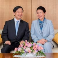 Emperor Naruhito and Empress Masako pose at their residence in Tokyo in February. | IMPERIAL HOUSEHOLD AGENCY / VIA REUTERS