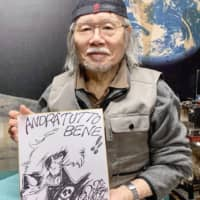 This undated photo shows Leiji Matsumoto holding an illustration from the animation series 'Space Pirate Captain Herlock.' | KYODO