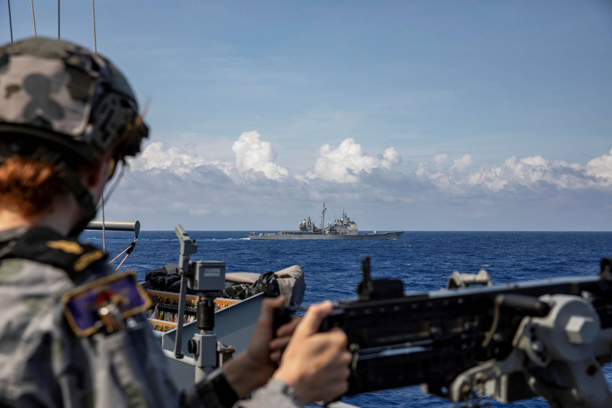 The USS Bunker Hill moves into position to conduct a joint training firing serial with HMAS Parramatta during a recent transit of the South China Sea. | AUSTRALIA DEPARTMENT OF DEFENCE