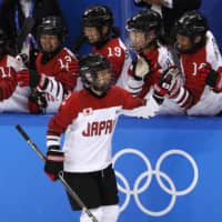 Japan's Shiori Koike celebrates with her teammates after scoring against Sweden during the women's classification game at the 2018 Pyeongchang Olympics on Feb. 18, 2018, in Gangneung, South Korea. | REUTERS