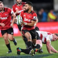 The Crusaders' Richie Mo'unga avoids a tackle from Jaques Van Rooyen of South Africa's Lions during the Super Rugby Final in Christchurch, New Zealand, on Aug. 4, 2018. | REUTERS
