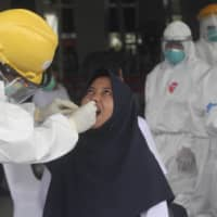 More than 2,200 Indonesians have died with coronavirus symptoms, data shows