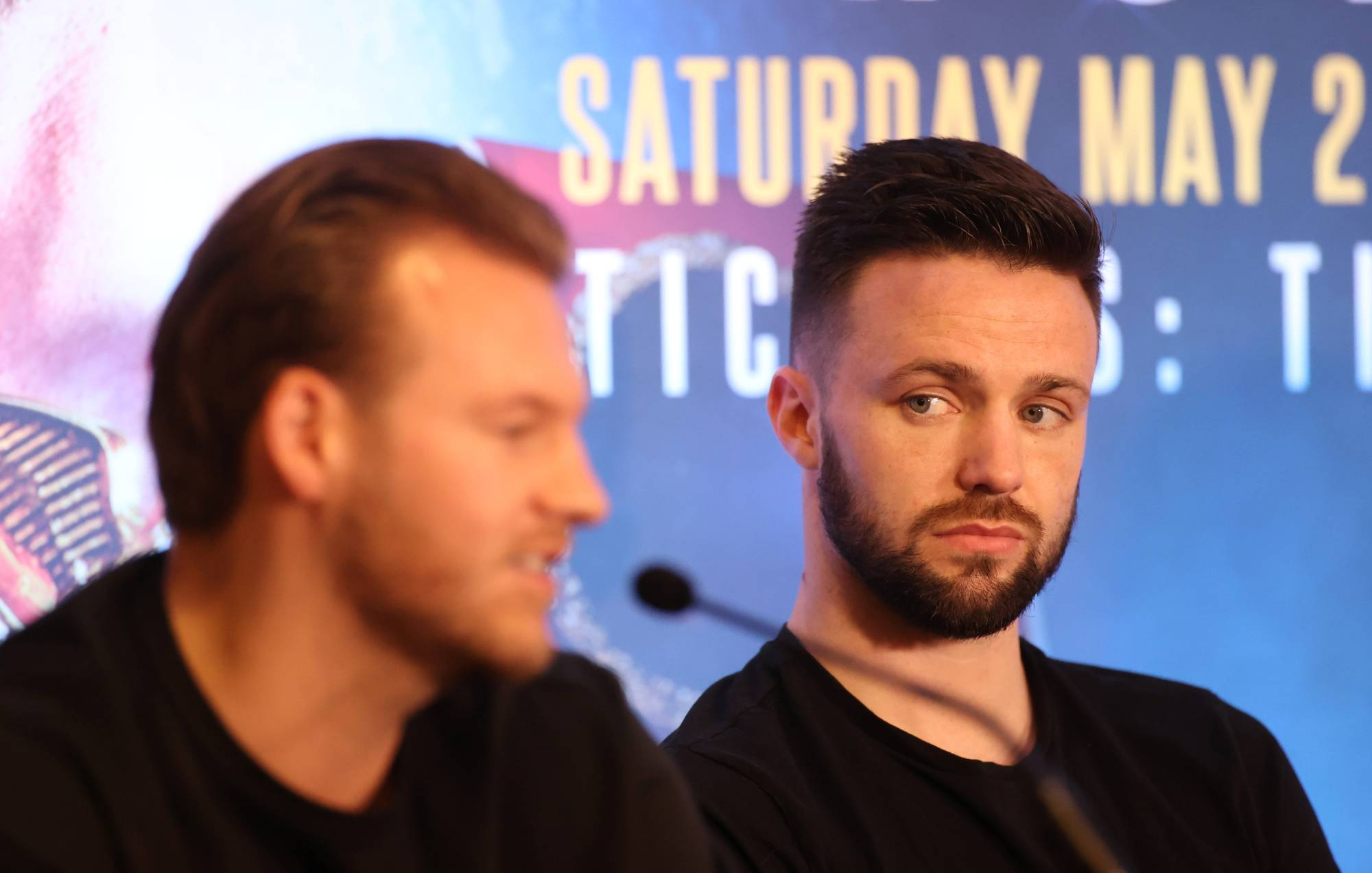Josh Taylor (right) looks on during a news conference promoting his May 2 fight against Apinun Khongsong on March 4 in Glasgow, Scotland. | REUTERS