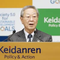 Keidanren Chairman Hiroaki Nakanishi says Japan's custom of requiring that documents be stamped with a seal is 'nonsense.' | KYODO