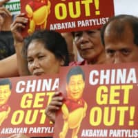 Demonstrators rally outside the Chinese Consulate to protest a two-day state visit by China's president, Xi Jinping, in Manila in November 2018. China's embassy released a song that is unpopular with some Filipinos, many of whom see China as a maritime aggressor in disputed waters. | AP