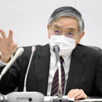 Bank of Japan Gov. Haruhiko Kuroda attends a news conference in Tokyo on Monday.  | KYODO