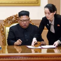 Kim Yo Jong, sister of North Korean leader Kim Jong Un, helps Kim sign a joint statement following a summit with South Korean President Moon Jae-in at the Paekhwawon State Guesthouse in Pyongyang in September 2018. | PYONGYANG PRESS CORPS / POOL / VIA AP