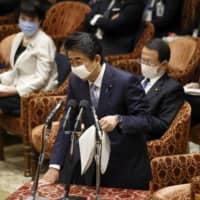 Prime Minister Shinzo Abe speaks during a Lower House Budget Committee session on Tuesday in Tokyo.  | KYODO