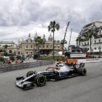Mercedes driver Lewis Hamilton steers his car during the Monaco Grand Prix on May 26 in Monaco. | AP