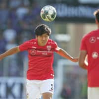 VfB Stuttgart midfielder Wataru Endo warms up during a German second-division match on Aug. 24 in Aue, Germany. | KYODO