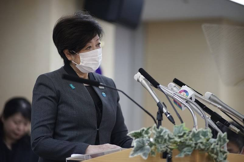 Tokyo Gov. Yuriko Koike speaks with a mask on while urging residents to further isolate themselves, during a news conference on April 24. | RYUSEI TAKAHASHI