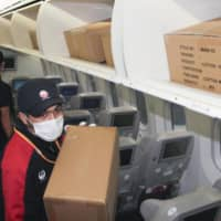 Airlines remodel idle passenger planes into air freighters to keep cargo moving