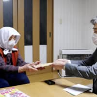 Small municipalities in Japan begin handing out cash for virus relief