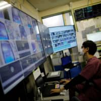 A medical worker monitors remotely the live footages of patients at the Intensive Care Unit ward. | REUTERS