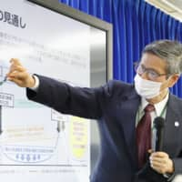 Japan's medical system overloaded but virus experts see signs of hope