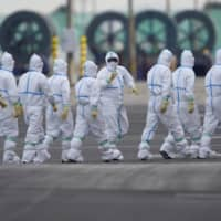 Japan's medical workers facing worsening shortages of protective gear, survey says