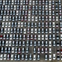 New vehicles sit parked at an automotive processing terminal operated by WWL Vehicle Services Americas Inc., a subsidiary of Wallenius Wilhelmsen Logistics, in this aerial photograph taken over the port of Los Angeles in Wilmington, California, on April 28. | BLOOMBERG