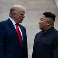 U.S. President Donald Trump and North Korean leader Kim Jong Un stand on North Korean soil while walking to South Korea in the Demilitarized Zone in June last year. | AFP-JIJI