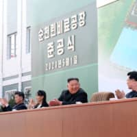 North Korean leader Kim Jong Un attends a ceremony marking the completion of a fertilizer plant, together with his younger sister, Kim Yo Jong, in a region north of Pyongyang, in this image release on May 2. | KCNA / VIA REUTERS