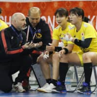 Japan women's handball coach Ulrik Kirkely speaks to his players during a match at the world championships on Dec. 11, 2019, in Kumamoto. | KYODO