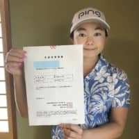 Ayako Uehara is one of 14 female golfers from Okinawa who raised funds to help with the restoration efforts for Shuri Castle.