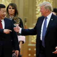 U.S. President Donald Trump and Chinese leader Xi Jinping arrive for a state dinner at the Great Hall of the People in Beijing in November 2017.  | REUTERS
