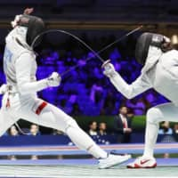 Fencer Sera Azuma (right) competes against Poland's Julia Walczyk at the world championships on July 19, 2019, in Budapest. | KYODO