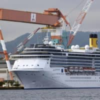 Over 100 Filipino crew leave virus-hit cruise ship in Nagasaki