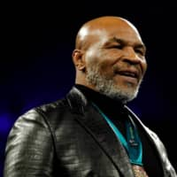 Mike Tyson attends the WBC heavyweight title fight between Deontay Wilder and Tyson Fury on Feb. 22 in Las Vegas. | REUTERS
