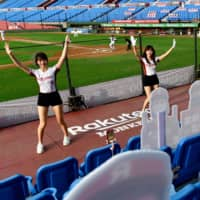 Rakuten Monkeys cheerleaders perform in front of lifesize cutouts depicting a crowd of spectators during a Chinese Professional Baseball League game between Rakuten and CTBC Brothers in Taoyuan, Taiwan, on Saturday. | AFP-JIJI