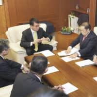 Defense Minister Taro Kono meets with executives of the Liberal Democratic Party's Akita prefectural chapter at the Defense Ministry in Tokyo on Feb. 12. | KYODO