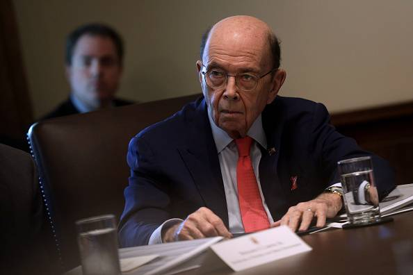 U.S. Secretary of Commerce Wilbur Ross listens during a meeting at the White House in Washington last October. | GETTY IMAGES / KYODO