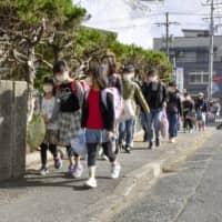 Elementary school children walk to school in the city of Tottori Thursday morning as schools in the prefecture reopened. | KYODO