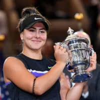 Canada's Bianca Andreescu holds the U.S. Open championship trophy after beating Serena Williams in the women's singles final on Sept. 7 in Flushing, New York. | USA TODAY / VIA REUTERS
