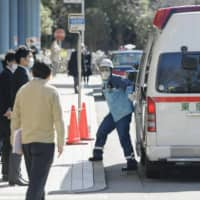 An ambulance arrives at a hospital in Tokyo accepting new coronavirus patients.  | KYODO