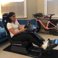 W Series champion Jamie Chadwick drives on her esports setup in her apartment in London on Tuesday. | JAMIE CHADWICK / VIA REUTERS