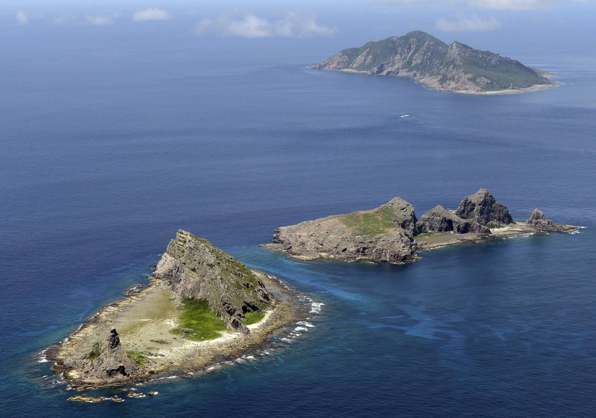Two Chinese coast guard vessels entered Japanese territorial waters off the Senkaku Islands in the East China Sea on Saturday, marking the second straight day Chinese government ships sailed in the waters. | KYODO