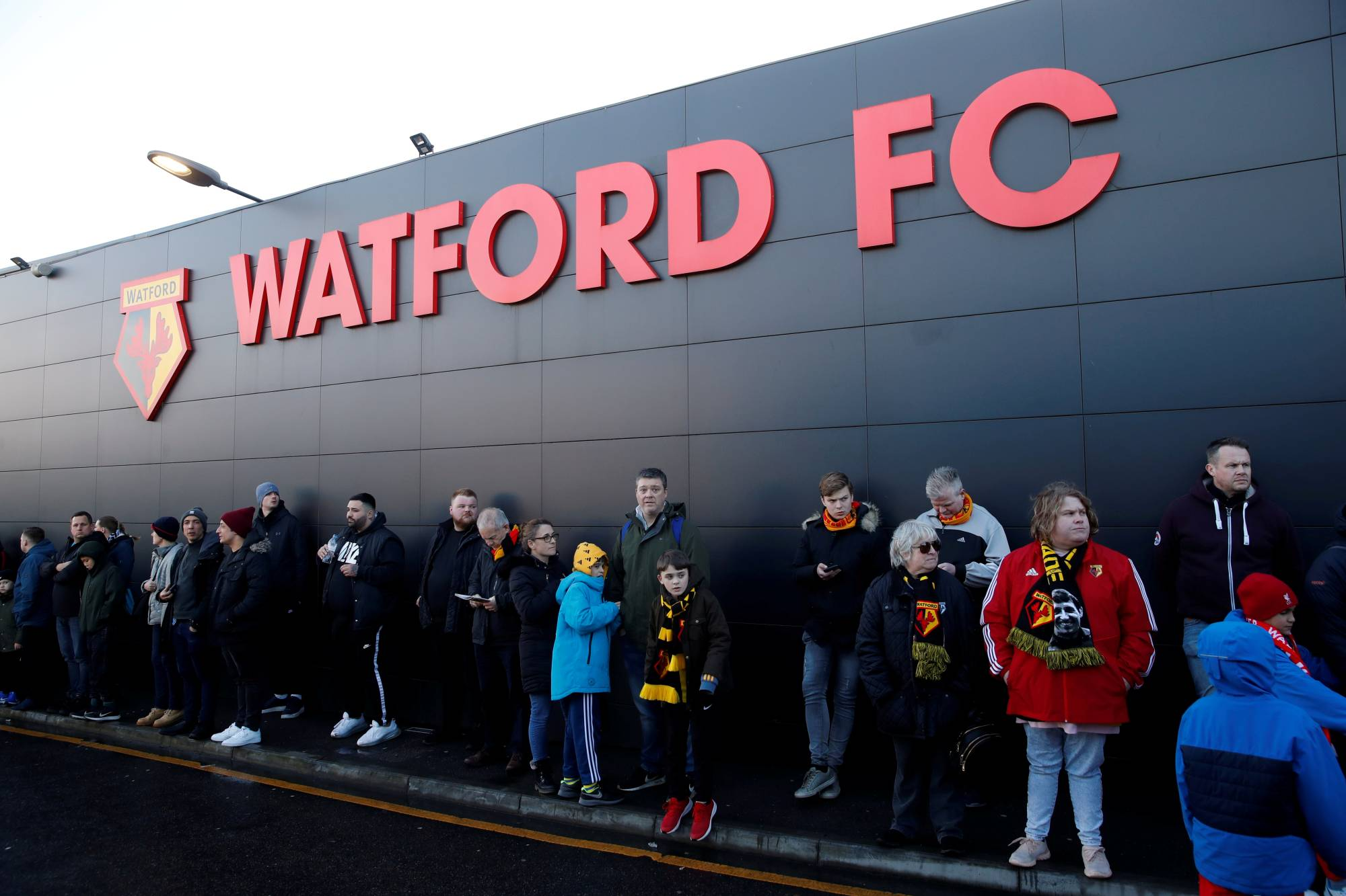 Fans wait outside Watford's home stadium of Vicarage Road on Feb. 29 in Watford, England. | REUTERS