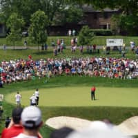 Fans watch as Tiger Woods putts on the 11th green during the final round of the 2019 Memorial Tournament in Dublin, Ohio, on June 2. | USA TODAY / VIA REUTERS