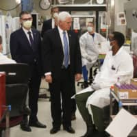 U.S. Vice President Mike Pence visits the molecular testing lab at Mayo Clinic on April 28.  | AP