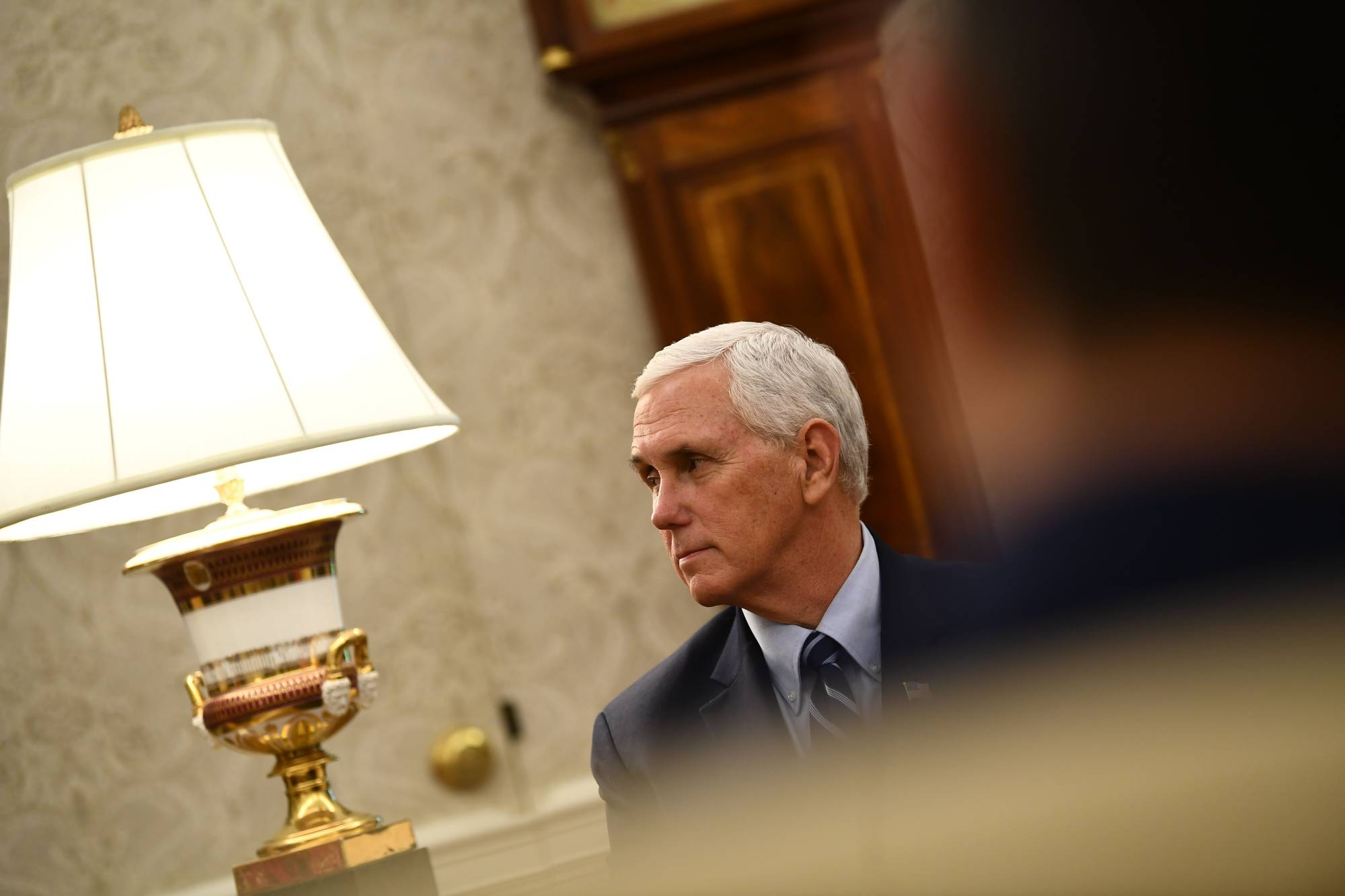 U.S. Vice President Mike Pence listens as U.S. President Donald Trump speaks during a meeting with Texas Gov. Greg Abbott on Thursday in the Oval office of the White House. | AFP-JIJI