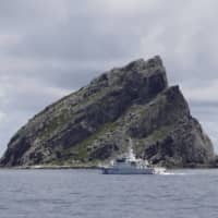 A Japan Coast Guard patrol ship sails around the Japanese-controlled Senkaku Islands in the East China Sea in September 2012. | REUTERS