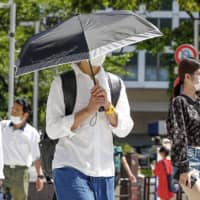 Fears of heat illnesses surge as Japan masks up for the summer