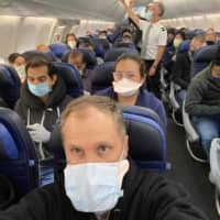 U.S. airlines balance fewer flights with angry travelers seeking social distance