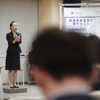 During Tokyo Gov. Yuriko Koike's message to the residents of Tokyo, her sign language interpreter appeared wearing a clear mask, enabling viewers to lip read. | RYUSEI TAKAHASHI