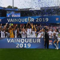 Lyon's players celebrate after winning the Champions Trophy against Paris Saint-Germain in the annual match between the women's league and cup champions on Sept. 21 in Guingamp, France. | AFP-JIJI