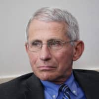 Dr. Anthony Fauci, director of the National Institute of Allergy and Infectious Diseases, listens during the daily coronavirus briefing at the White House on April 6 in Washington. | AFP-JIJI