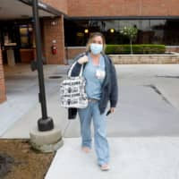 Canadian nurse Nikki Hillis-Walters walks to her car after her shift at Beaumont Hospital in Grosse Pointe, Michigan, on Monday. | AFP-JIJI