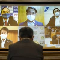 Prefectural governors from across the nation hold a video conference to discuss post-state of emergency measures on Tuesday. | KYODO