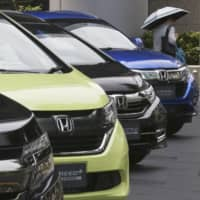Honda cars are displayed at the automaker's headquarters in Tokyo. The Japanese automaker sank deeper into losses for the fiscal quarter ended in March 2020, as the damage to the industry set off by the coronavirus outbreak hurt sales and crimped production. | AP